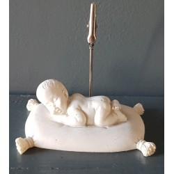 Bébé sur coussin porte photo